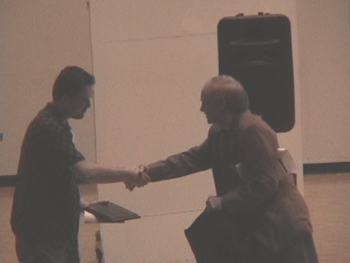Tom Wells presents Joe Dangerfield with a citation of thanks